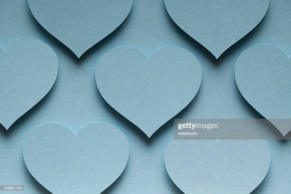 Blue hearts on blue background : Stock Photo