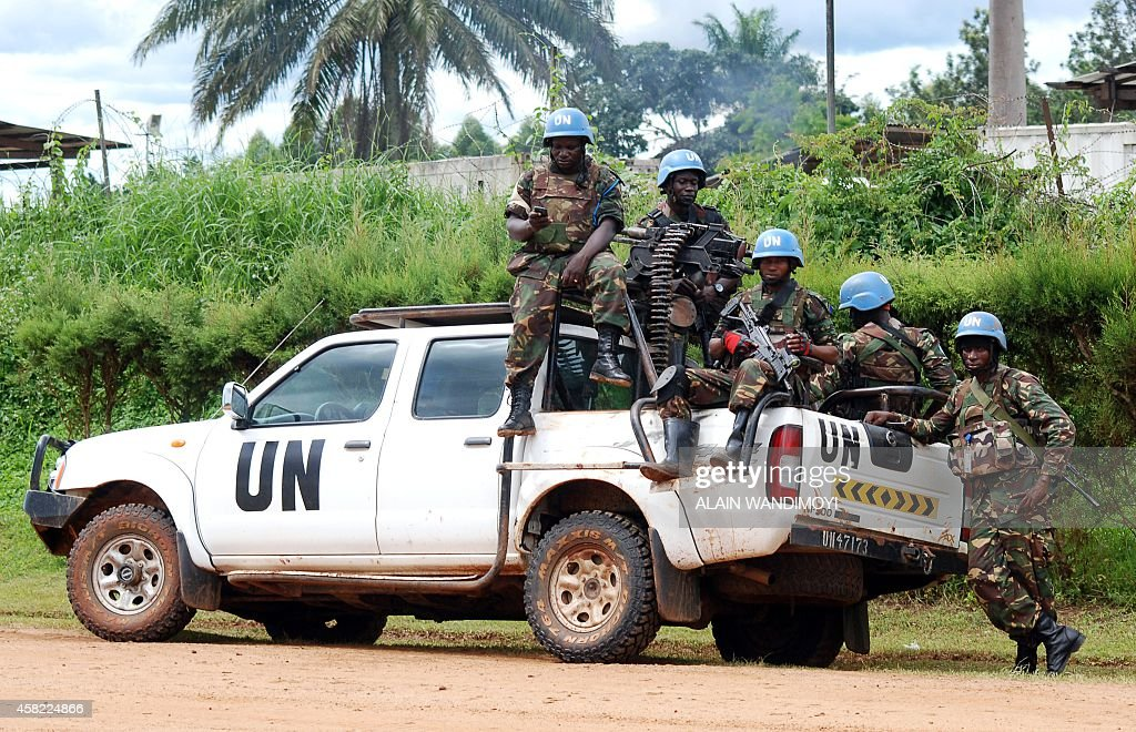 Blue helmet members of the United Nations Organization Stabilization Mission in the Democratic Republic of Congo MONUSCO sit on the back of a UN...