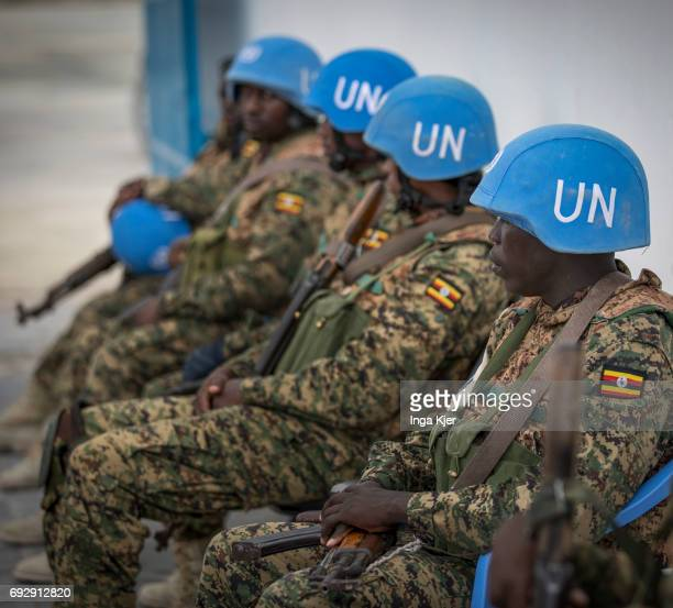 Blue helmet soldiers are sitting in a row on the protected outdoor area of the airport of Mogadishu on May 01 2017 in Mogadischu Somalia