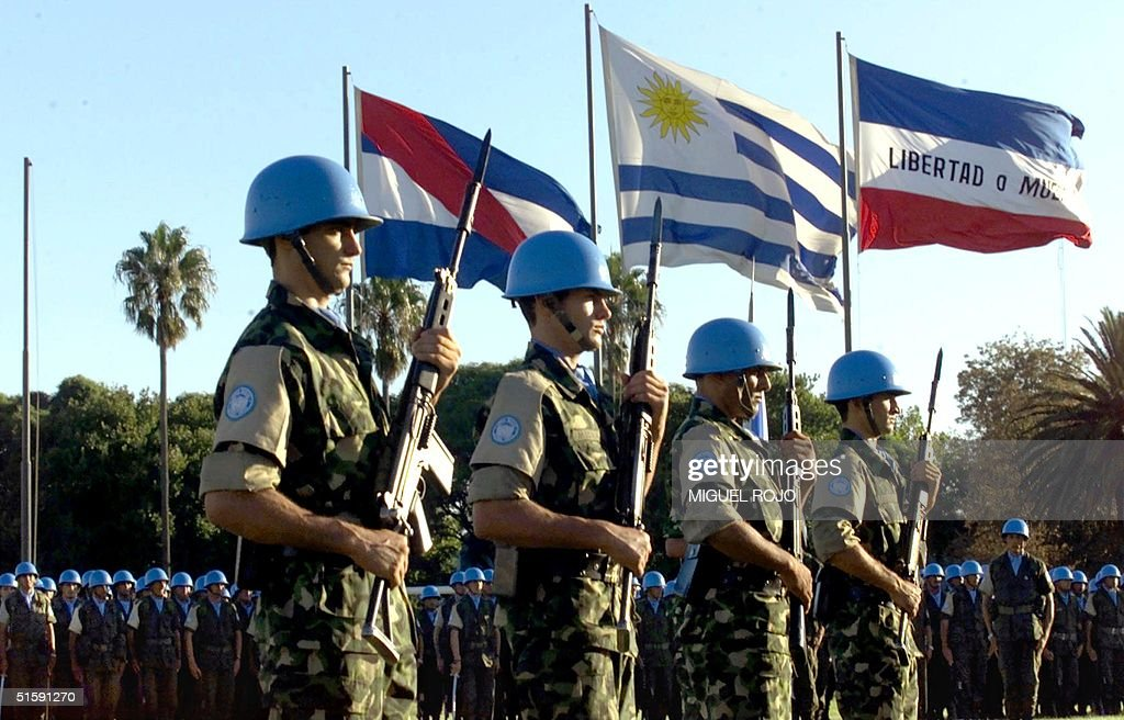 'Blue helmet' soldiers of the United Nations stand in ranks 15 March 2001 in Montevideo, Uruguay. AFP PHOTO/Miguel ROJO