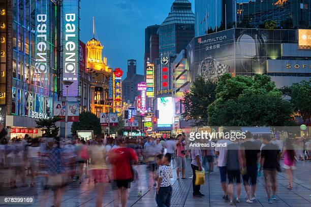 Blue hour shot of Nanjing Lu in Shanghai with visitors and LED illuminations, Shanghai, China, Asia