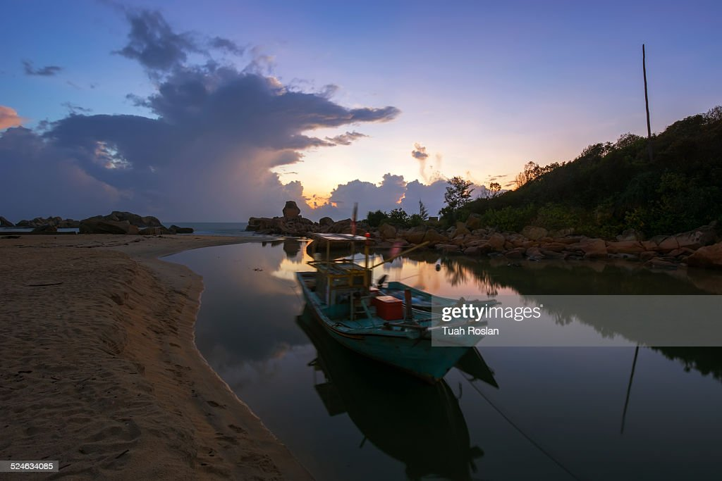 Blue hour with boat at the beach