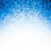 Blue winter ice textured background.