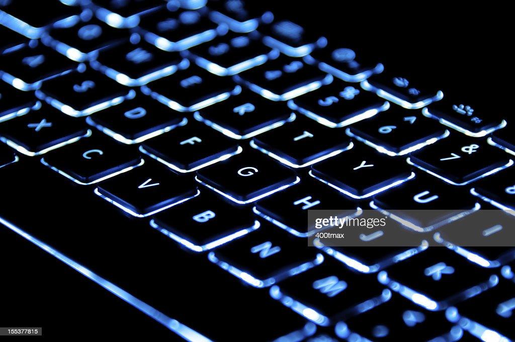 Blue illuminated keyboard : Stock Photo