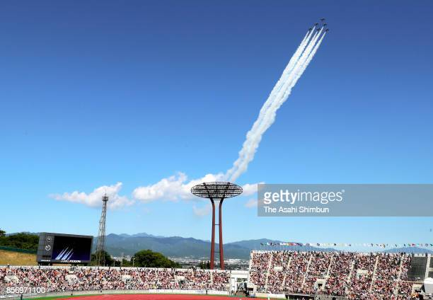 Blue Impulse Japan Air SelfDefense Force's Acrobatic Flight Performance team fly over the stadium during the opening ceremony of the National Sports...