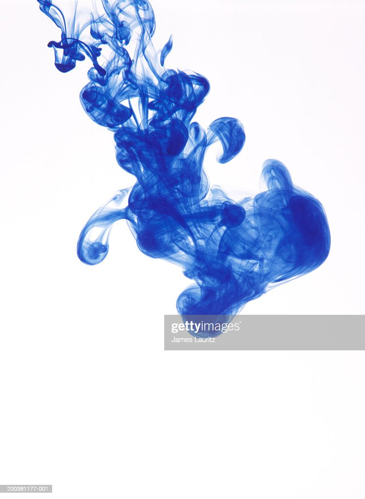 Blue ink suspended in water, on white background : Stock Photo