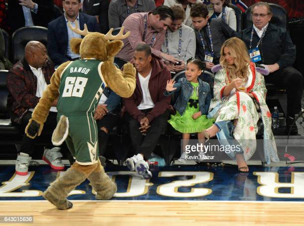 Blue Ivy Carter greets the mascot with her parents Jay Z and Beyonce Knowles at the 66th NBA AllStar Game at Smoothie King Center on February 19 2017...