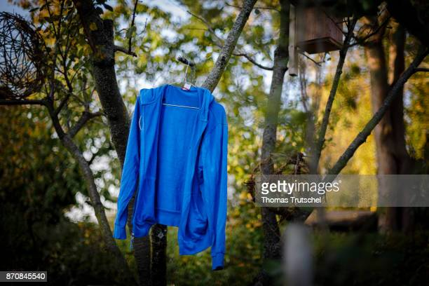A blue jacket hangs on a tree for air drying on October 17 2017 in Berlin Germany