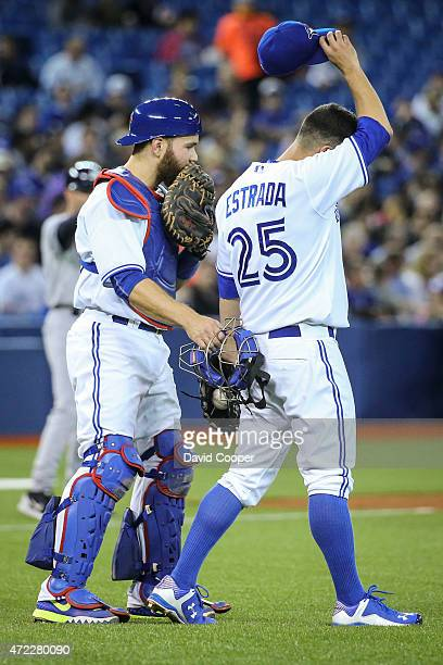 TORONTO ON MAY 5 Blue jays catcher Russell Martin tries to settle down his pitcher Marco Estrada during the game between the Toronto Blue Jays and...