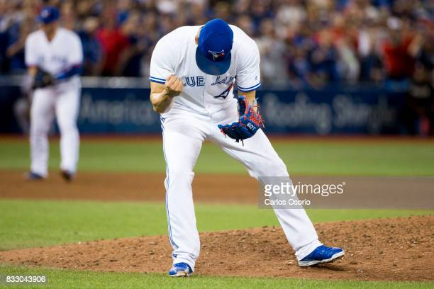 TORONTO ON AUGUST 16 Blue Jays closer Roberto Osuna pumps his fist after securing the save during the 9th inning of MLB action as the Toronto Blue...
