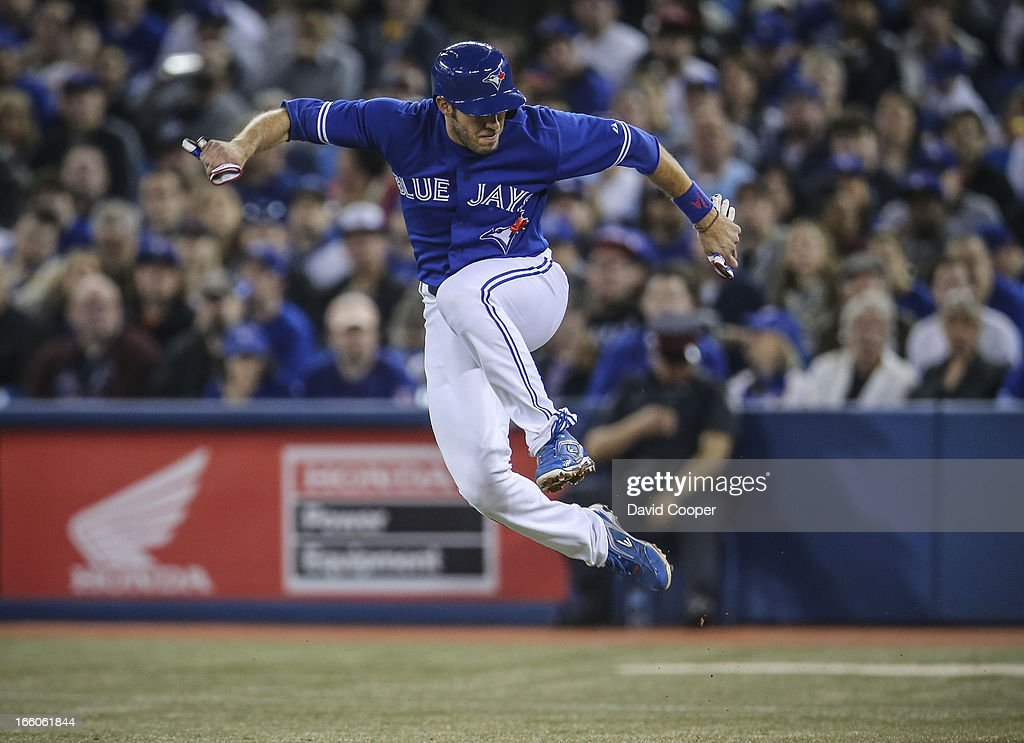 Blue Jays DH J.P.Arencibia jumps to avoid a hard hit ball by Maicer Izturis in the bottom of the 2nd during the game between the Toronto Blue Jays and the Boston Red Sox at The Rogers Centre.