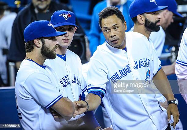 TORONTO ON APRIL 13 Blue Jays Hall of Fame player Roberto Alomar has a few words with young guns Daniel Norris who will start Tuesday and Aaron...