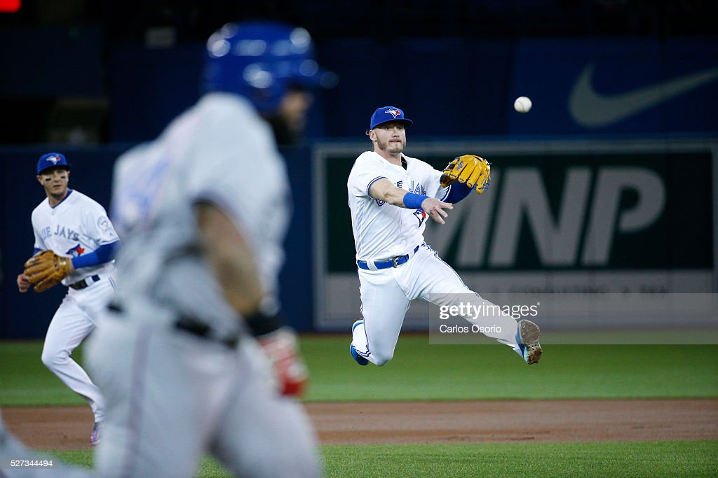 TORONTO, ON - MAY 2 - Blue Jays Josh Donaldson throws out Rangers Prince Fielder during the 1st inning of the MLB game between the Toronto Blue Jays and the Texas Rangers at the Rogers Centre on May 2, 2016.