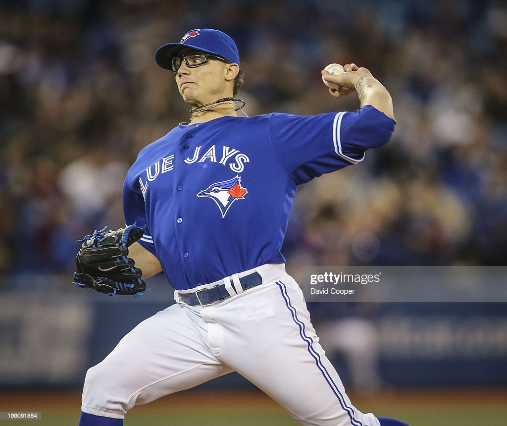 Blue Jays Relief pitcher Brett Cecil came on to pitch the 9th. Final score 13-0 as the Toronto Blue Jays loose to the Boston Red Sox at The Rogers Centre.
