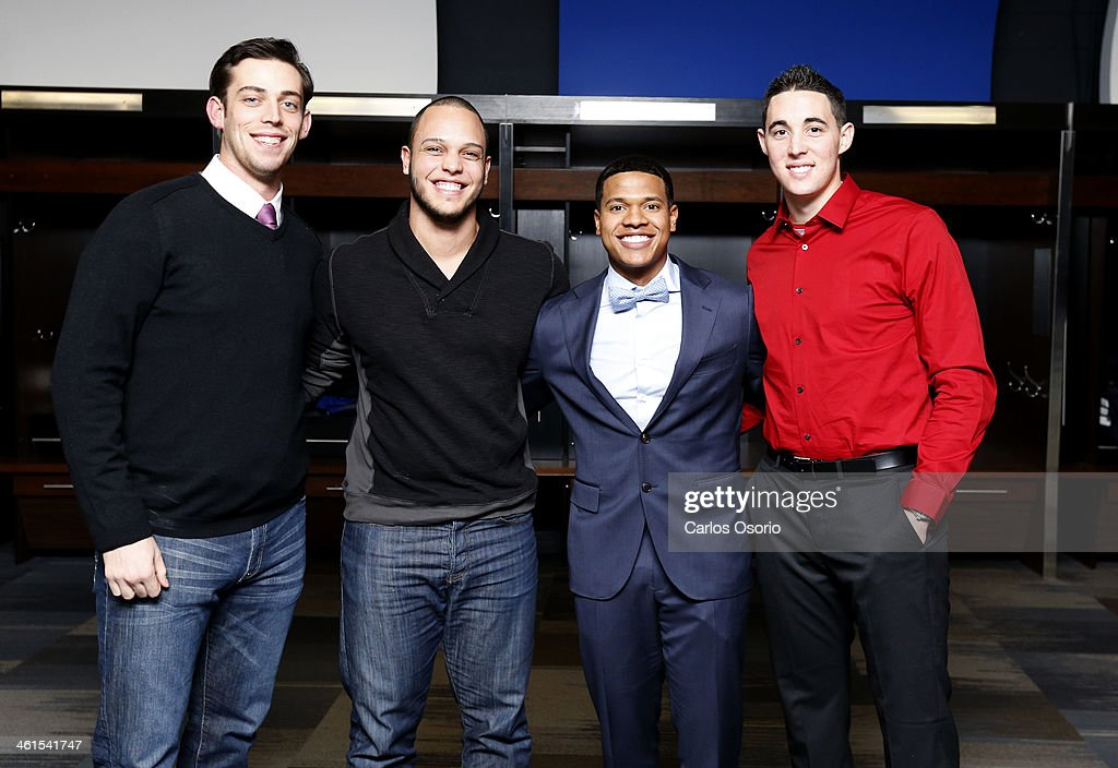 TORONTO, ON - JANUARY 8 - (L-R) Blue Jays rookies Sean Nolin, A.J. Jimenez, Marcus Stroman and Aaron Sanchez pose for a photograph during a rookie camp held at Rogers Centre on January 8, 2014.