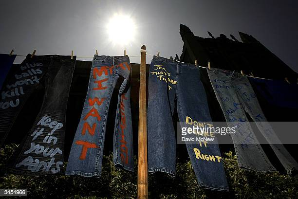 Blue jeans with messages challenging misconceptions about sexual violence are hung by the UCLA Clothesline Project on the University of California...