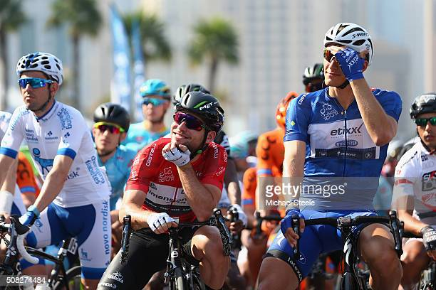Blue jersey and race leader Marcel Kittel of Germany and Etixx Quick Step lines up at the start alongside red jersey and points leader Mark Cavendish...