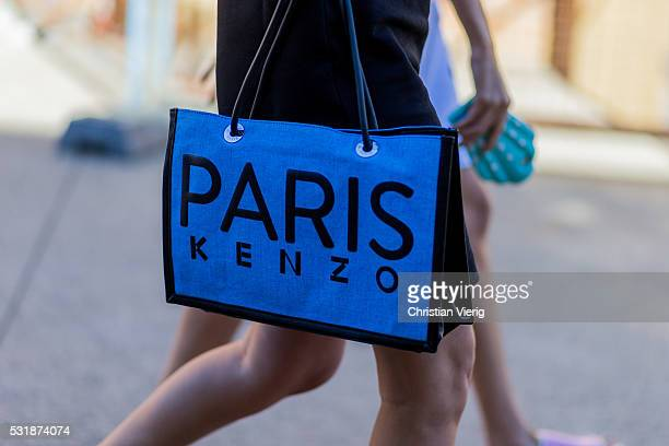 A blue Kenzo bag outside Bec Bridge at MercedesBenz Fashion Week Resort 17 Collections at Carriageworks on May 17 2016 in Sydney Australia