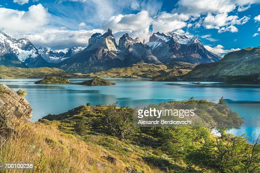 Blue lake on a snowy mountains background and cloudy sky Torres del paine : Stock Photo