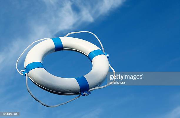 Blue life buoy thrown into air