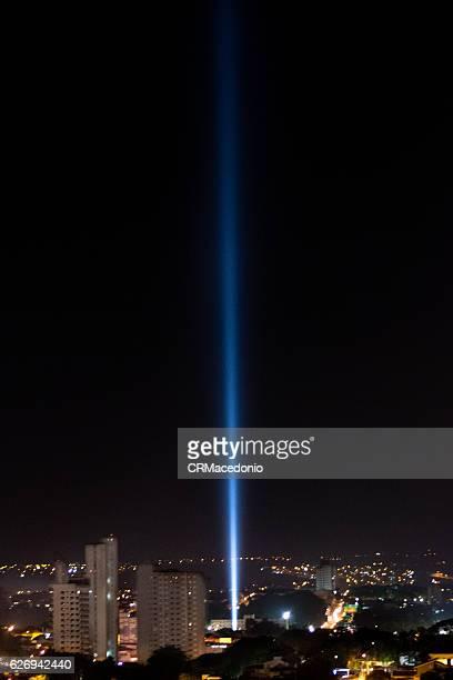 Blue light beam cutting through the sky into deep space.