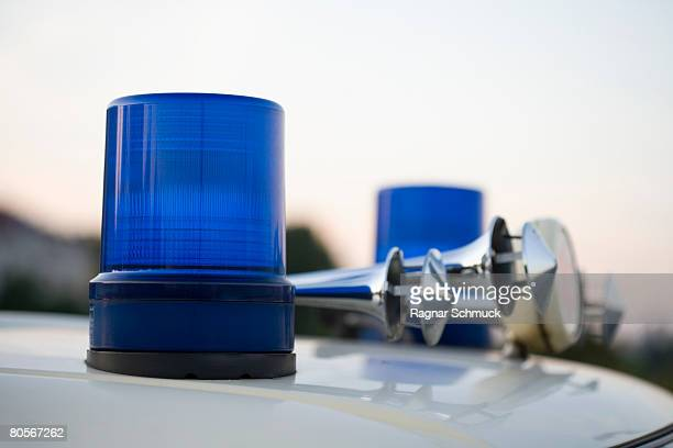 Blue lights and car horns on the roof of a police vehicle