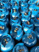 Blue LPG or propane tank under sun light