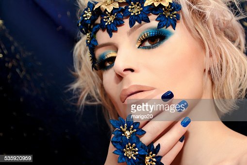 Blue manicure and makeup. : Stock Photo