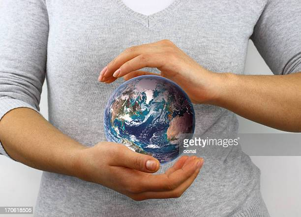 Blue marble between hands
