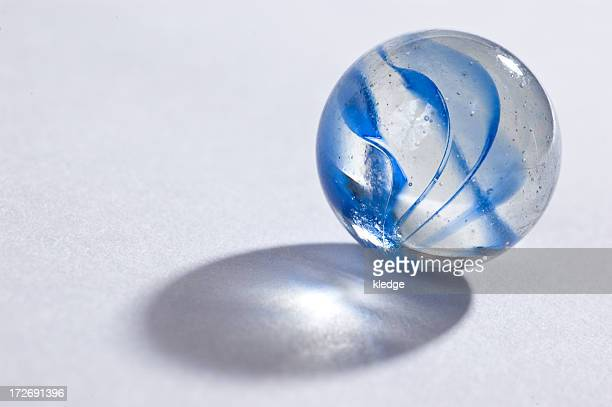 Blue marble with translucent shadow on white background