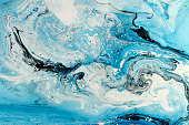 Blue marbling texture. Creative background with abstract oil painted waves, handmade surface. Liquid paint.