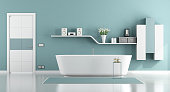 Blue moder bathroom with bathtub,closed door and shelf on wall - 3d rendering