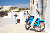 Blue - white moped on Santorini (Greece)