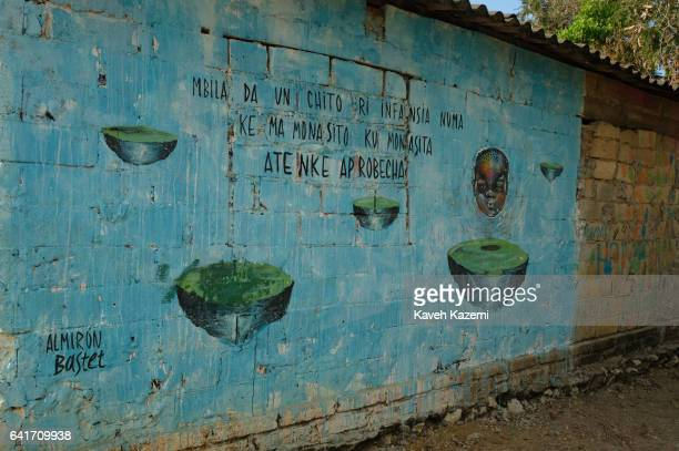 A blue mural with image of a young African boy and writings in SpanishBantú language only spoken by Palenque de San Basilio Afroamericans seen in the...