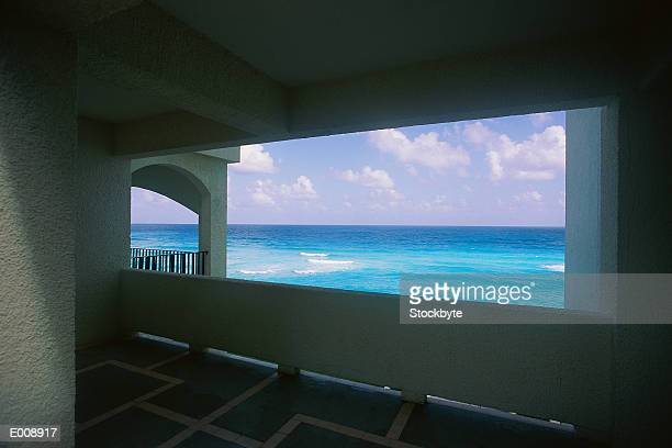 Blue ocean from window at beach house