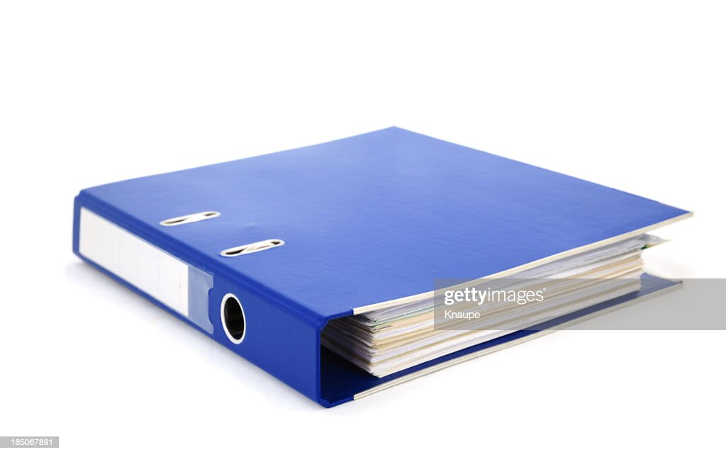 Blue office binder filled with paper on white background