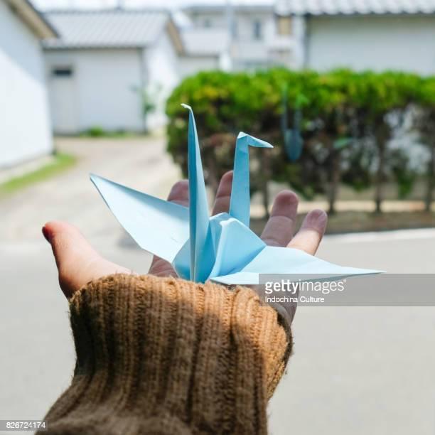 Blue Origami Crane on hand