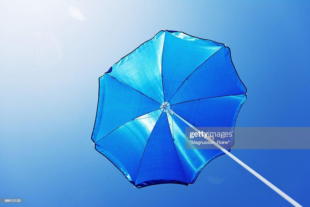 A blue parasol against a blue sky, Sweden.