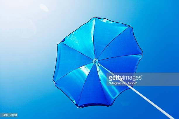 A blue parasol against a blue sky, Sweden.