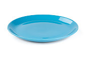 Pastel blue colored plate isolated on white background, front view, clipping path, without the cast shadow, included.