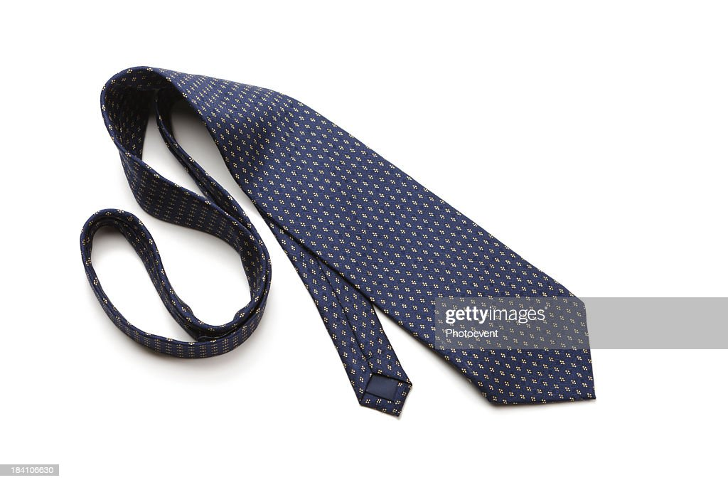 Blue patterned necktie laying on white background