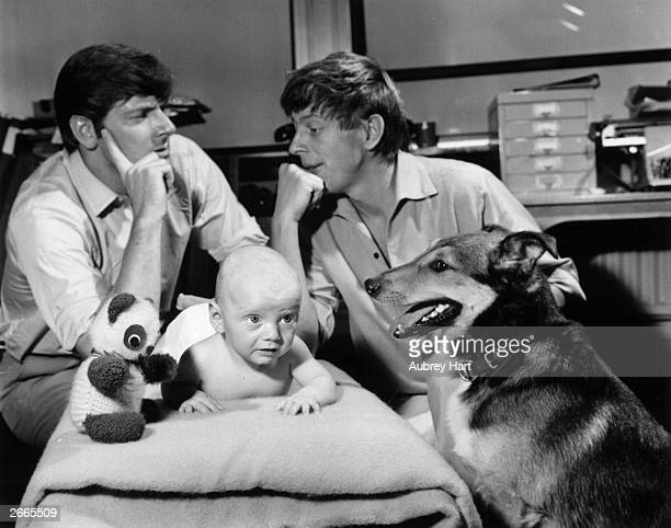 Blue Peter BBC children's TV presenters l to r Peter Purves and John Noakes share a worried moment with baby Daniel Simon Scott
