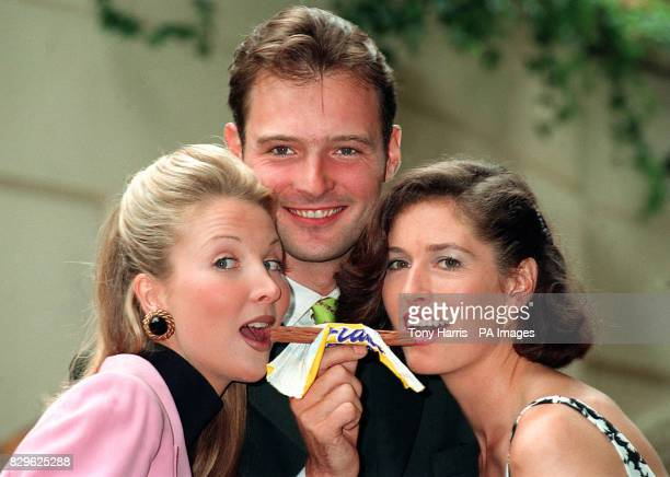 Blue Peter presenter John Leslie with models Kate Charman and Helen Greenwood launching the search for the new Cadbury's Flake girl
