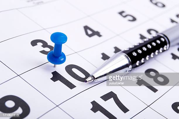 Blue Pin on Calendar with Pen