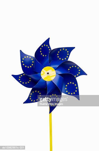 Blue pinwheel on white background