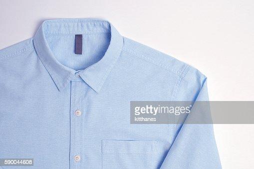 Blue plain cotton shirt White background : Stock Photo