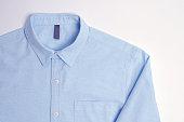 Blue plain cotton shirt White background.