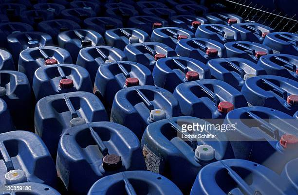 Blue plastic canisters (jerry cans) in rows