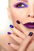 Blue purple fashion multicolored manicure and makeup on a woman in close-up.The nail design.