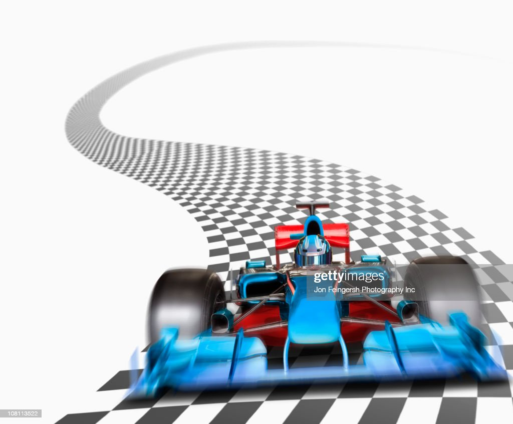 Blue race car driving on checkerboard road : Stock Photo